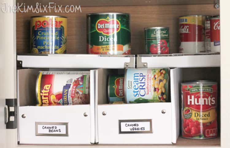 photo boxes on shelves storing canned goods