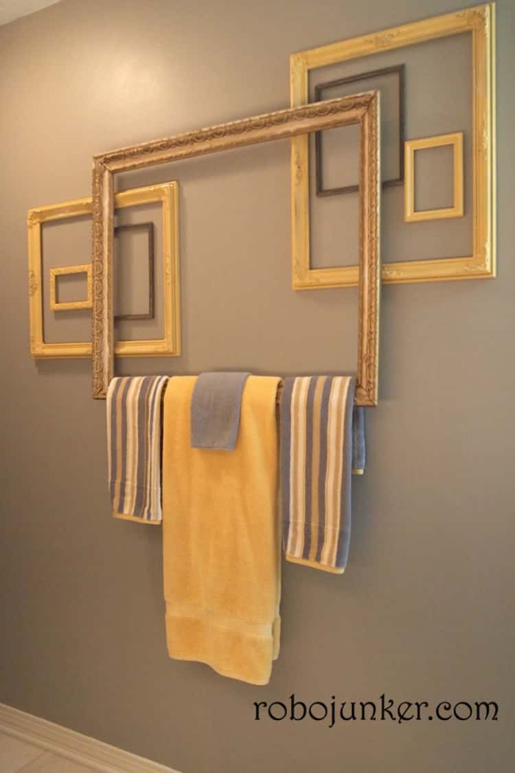 Use old photo frames as a towel holder