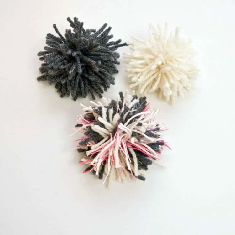 3 different colored pom-poms