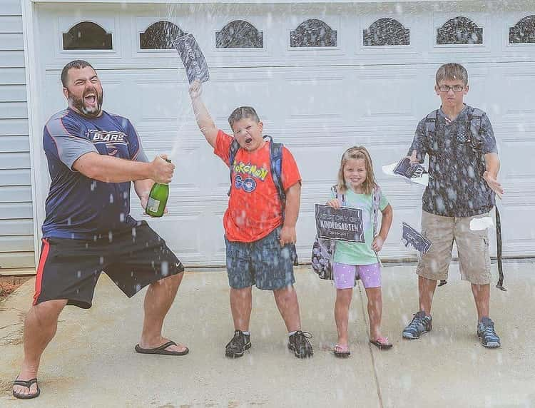 back to school photo ideas - Dad pops the bubbly while kids look on in disbelief