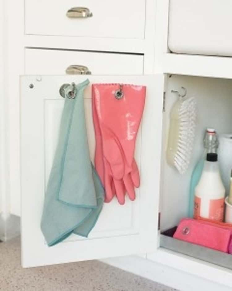 Put grommets in your cleaning gloves to hang them