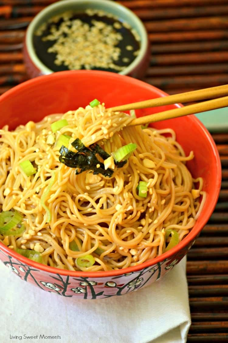 Ramen Noodles tossed in peanut soy sauce in a ceramic bowl with chopsticks