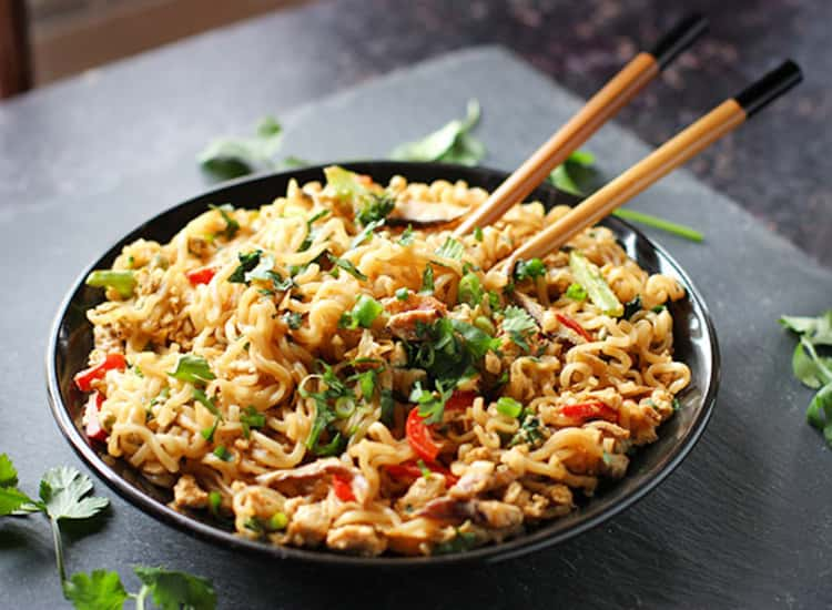 A bowl of Stir fried Ramen Noodles with chopsticks