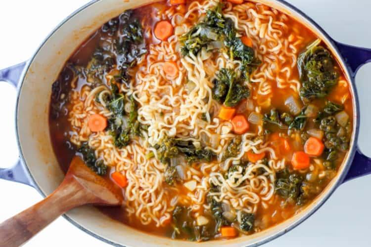 A bowl of ramen noodle vegetable soup