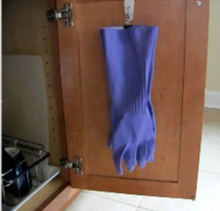 Hang rubber gloves in the closet using file binder clips
