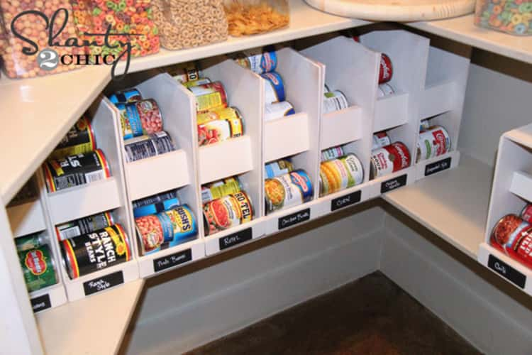 two tiered separator shelves storing canned goods