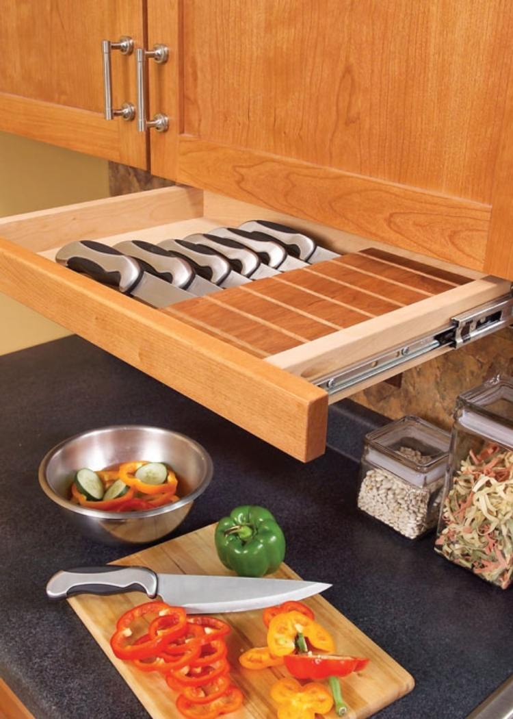 This perfectly sized cabinet drawer holds knives and keeps your counter clear for much needed room in tiny kitchens.