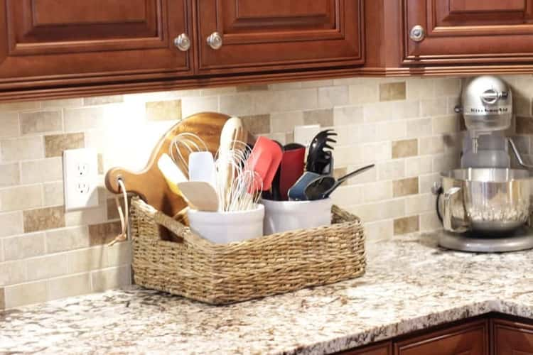 storing utensils upright in a basket on the kitchen counter