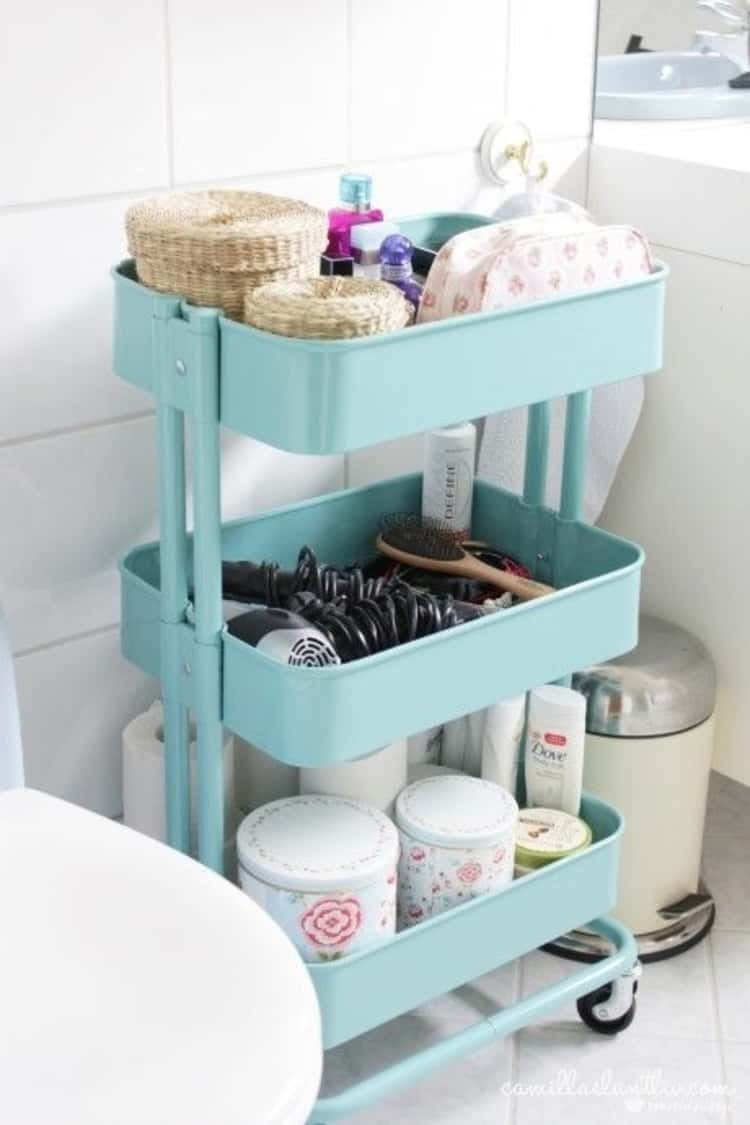 cute portable rolling cart in bathroom to store toilet paper rolls and toileteries, and towels