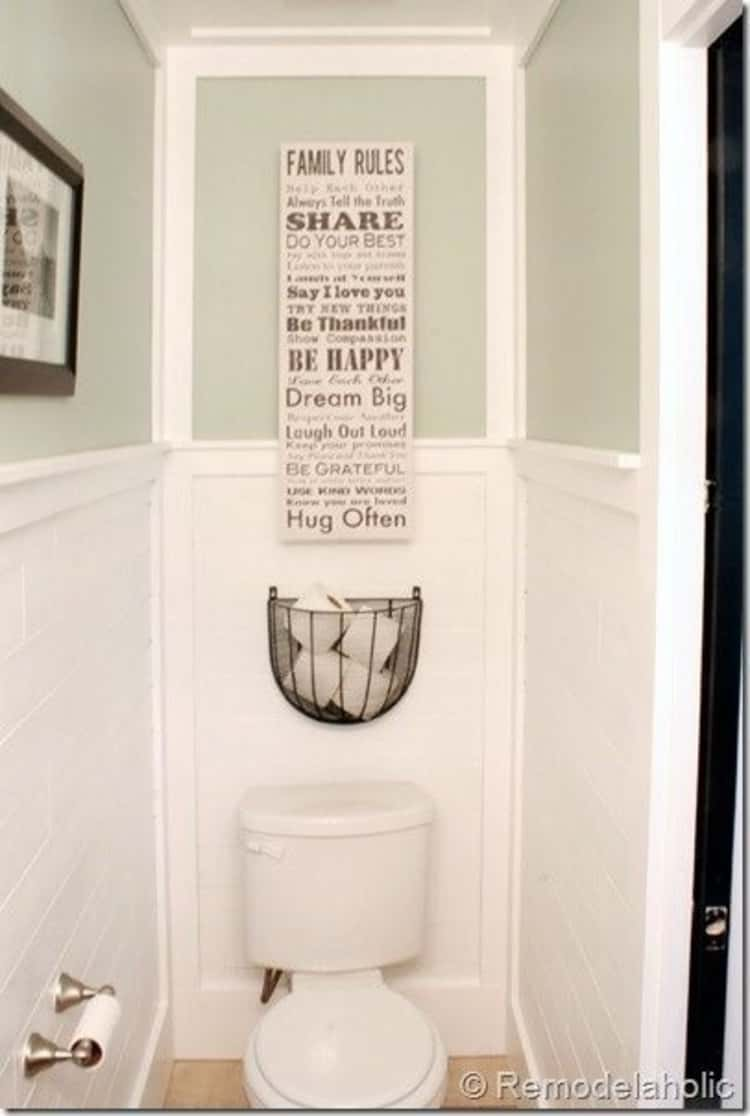 bathroom toilet paper storage using wire basket above the toilet