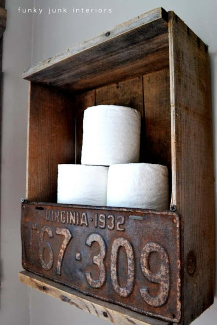 funky toilet paper holder in bathroom using an old wooden crate and vintage license plate