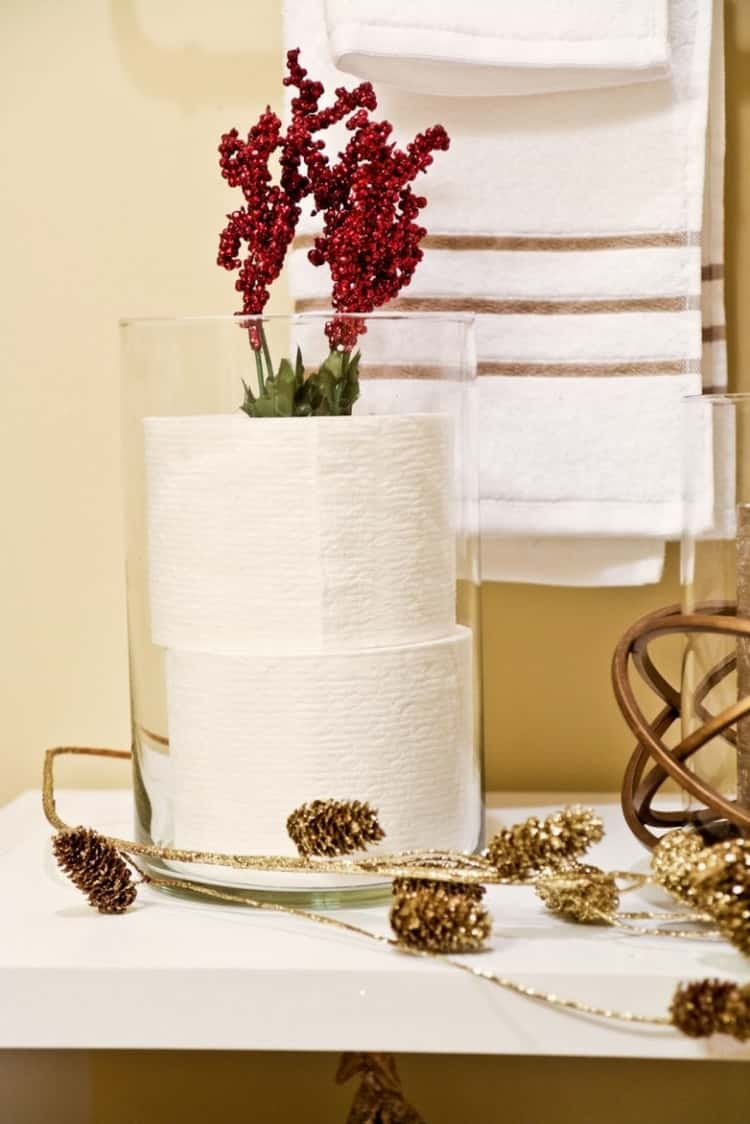 toilet paper storage in bathroom using hurricane vase, decorated for holidays