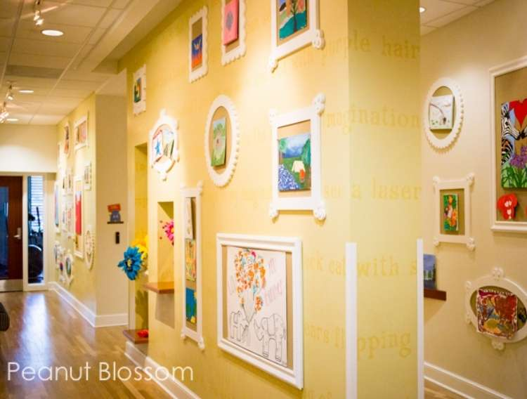 OneCrazyHouse kid friendly living room ideas Hallway with framed cork boards displaying kids artwork