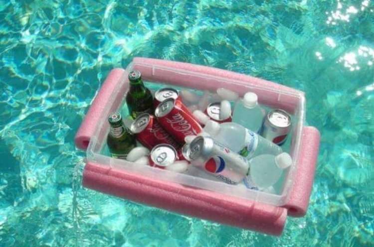 uses for pool noodles- cut noodles attached to a clear plastic bin containing ice and drinks floating in a pool