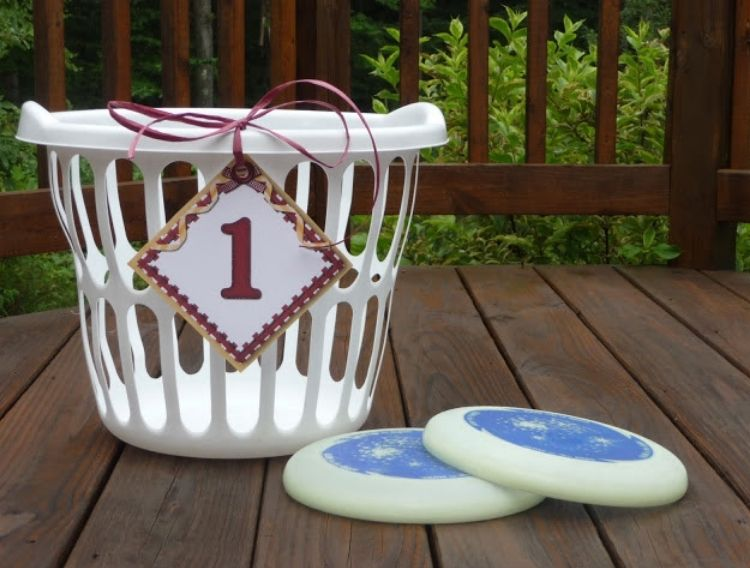 2 glow in the dark frisbees with a basket