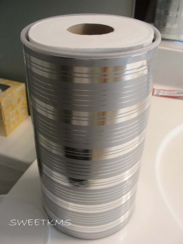 frugal toilet paper storage in bathroom reusing and recycling old oatmeal cannister and wrapping paper