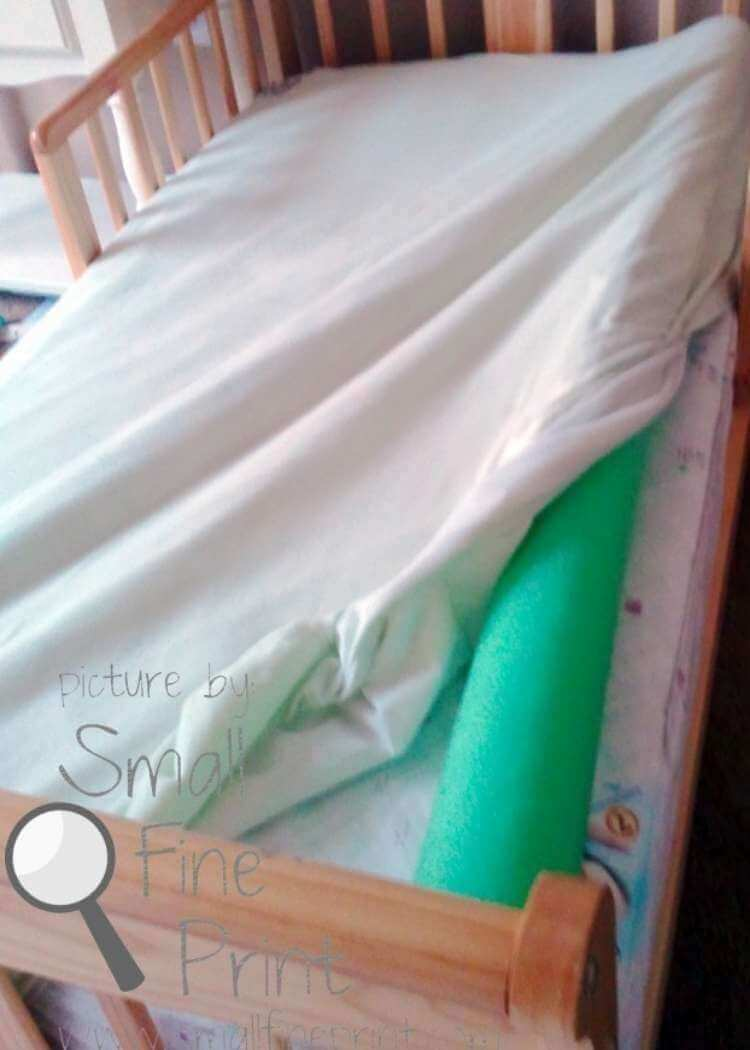 uses for pool noodles- a wide pool noodle tucked under a fitted sheet in a child's bed to help prevent them from rolling out of bed while sleeping