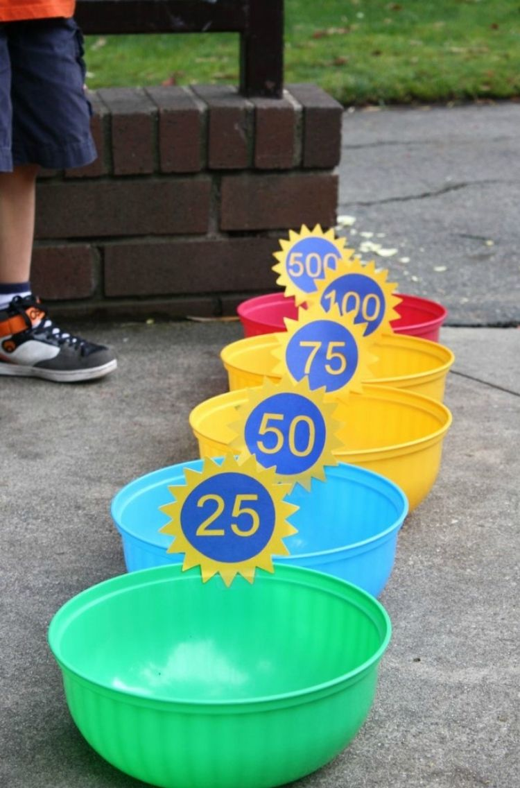 5 multi colored pails with numbers attached for points