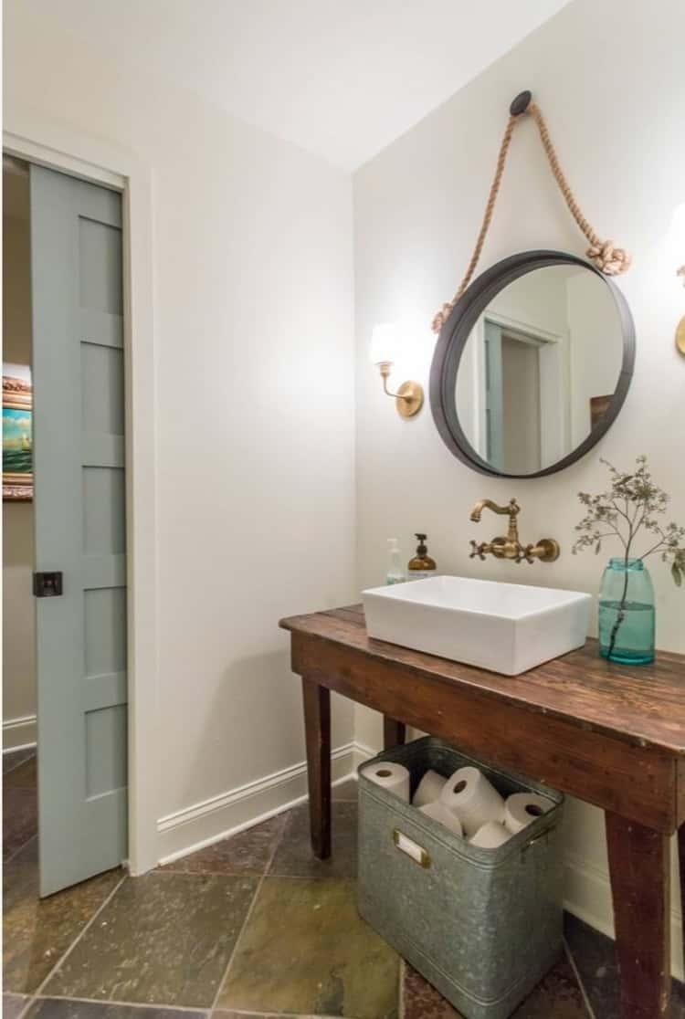 Store bathroom toilet paper in gavanized tub underneath bathroom sink for tidy organization