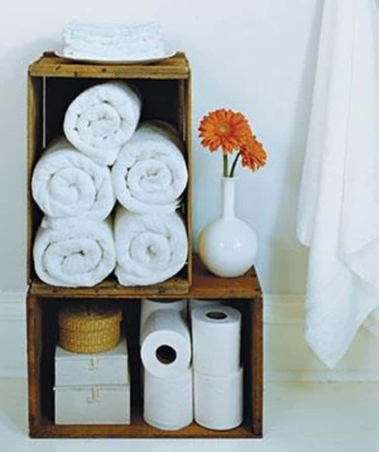 Use vintage and antigue crates in bathroom to put in toilet paper