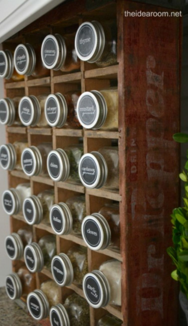rows of matching spice jars in a wooden shelf