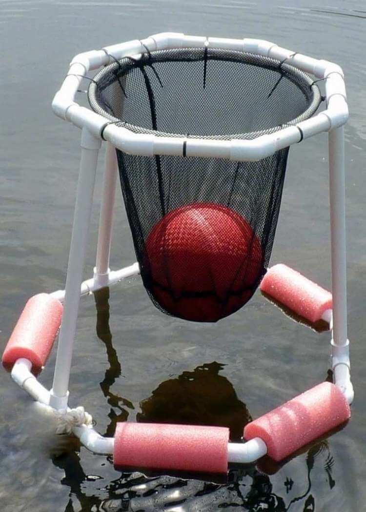 DIY uses for pool noodles- a floating basketball hoop made from white pvc piping, black netting, zip ties with cut pieces of pool noodles attached to the base so it will flaot