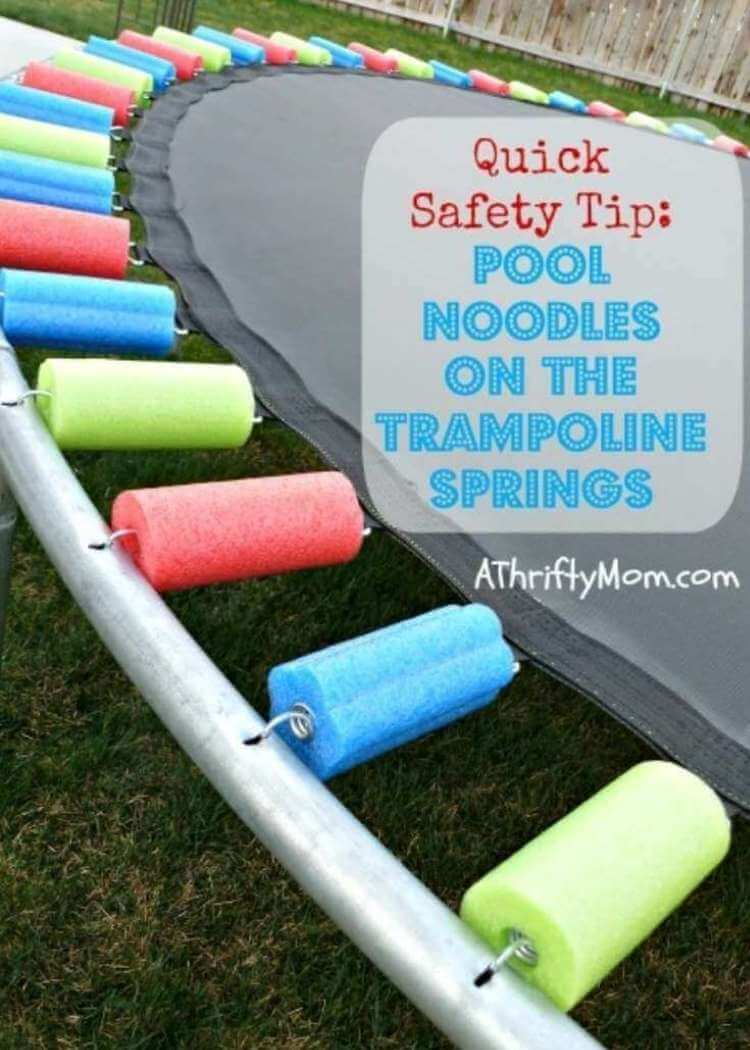 uses for pool noodles- a Trampoline with its springs covered in colorful pieces of pool noodles cut to the correct length to cover each spring