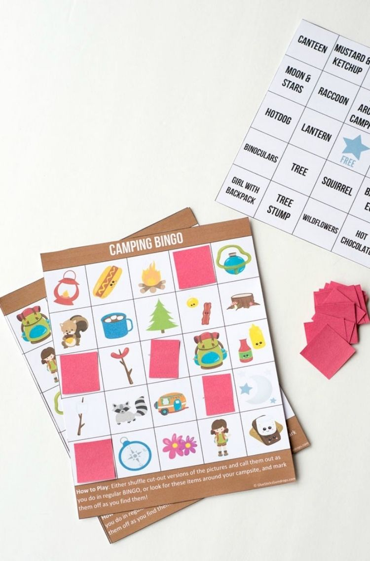 camping bingo game with cute images and red color paper to cover image