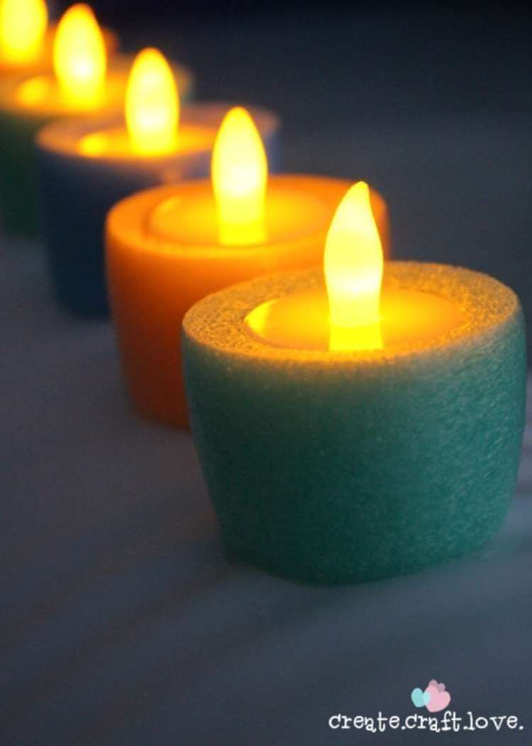 uses for pool noodles- floating candles made from tea lights and short pieces of pool noodles