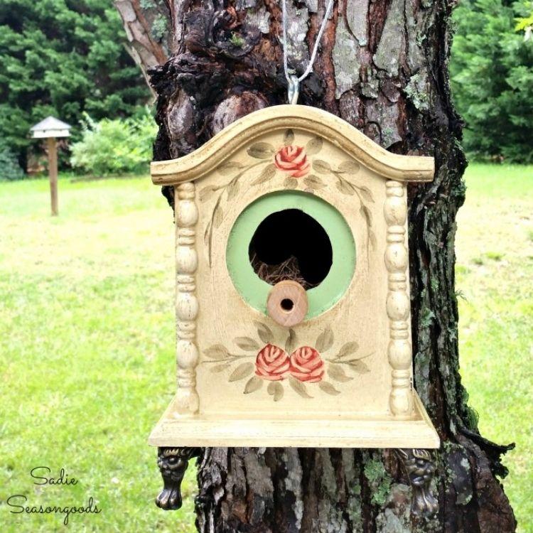 Old clock turned birdhouse