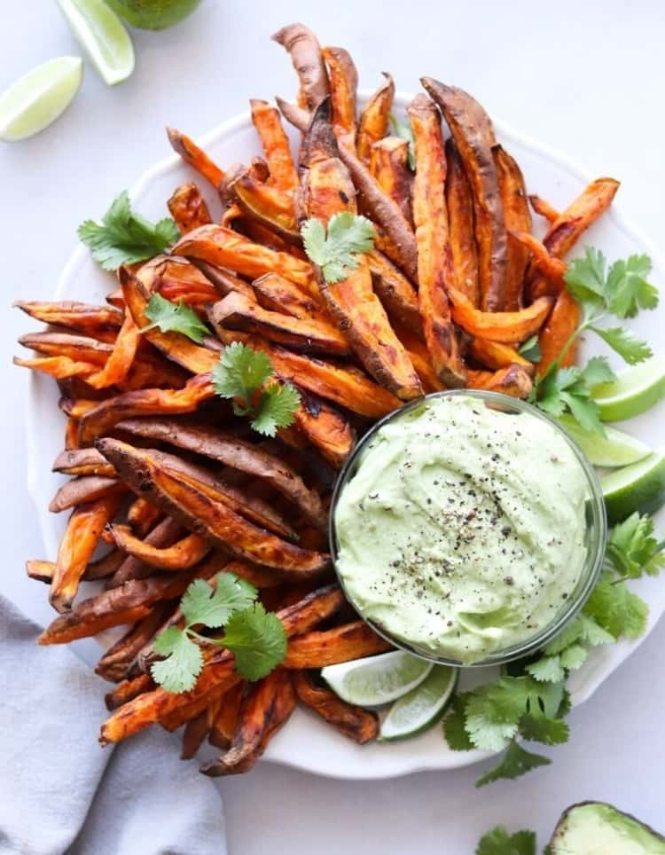 Air fryer sweet potato fries with an avocado aioli for a plant-based meal