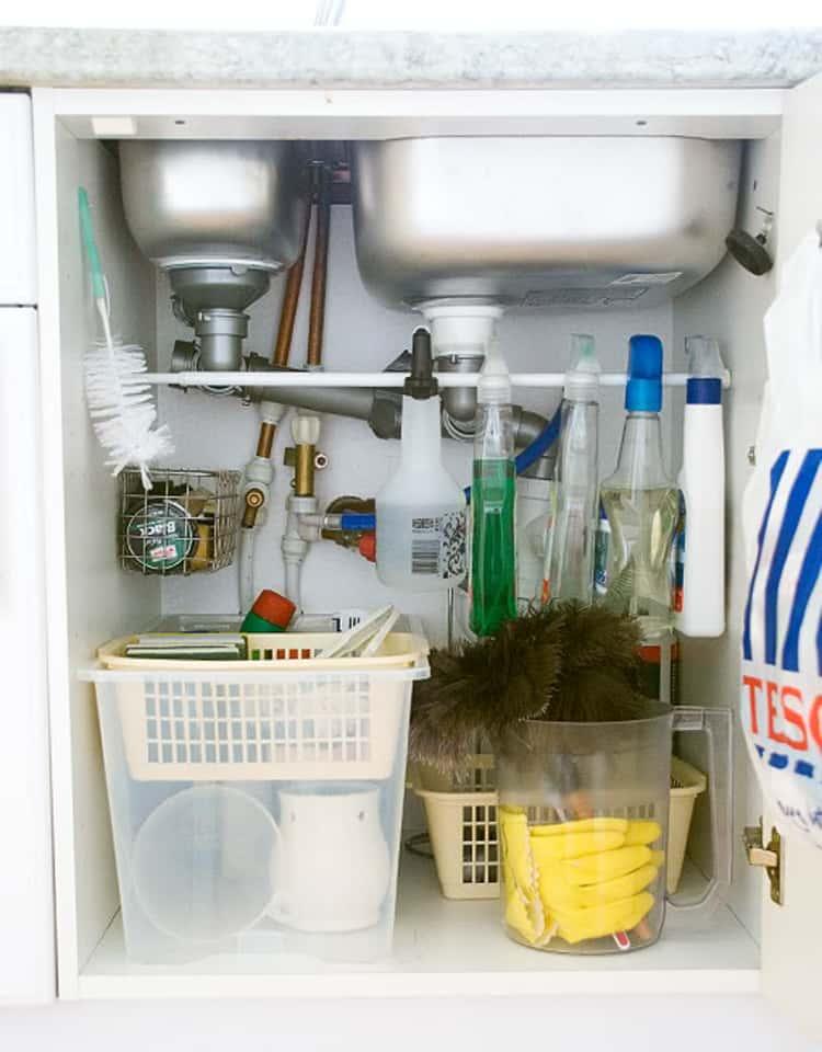 Cleaning appliances under sink roll hanger