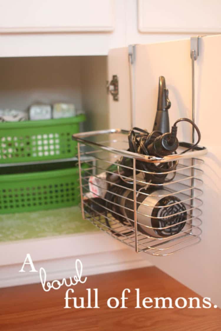 Under sink tongs and dryer storage drawer