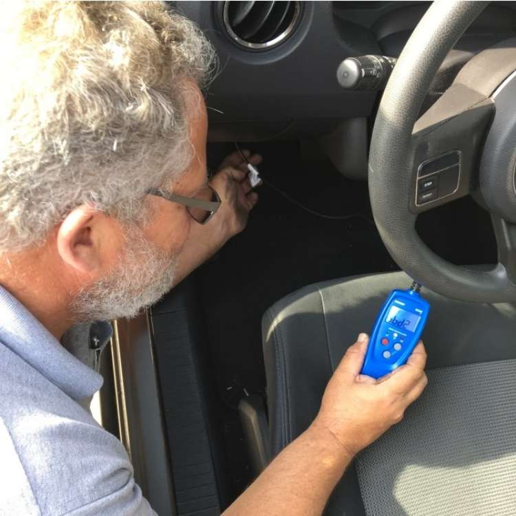 OneCrazyHouse Easy Car Repairs man holding machine inside drivers side of car taking measurement,