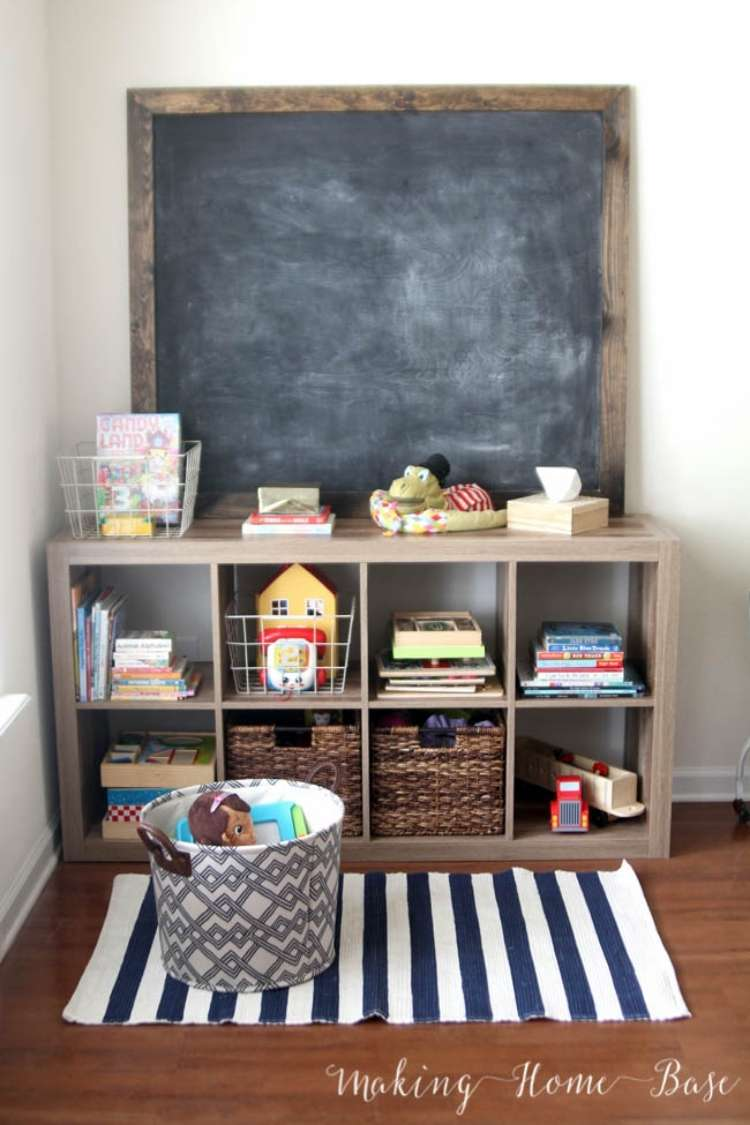 OneCrazyHouse kid friendly living room ideas Cube storage for toys with chalkboard on top