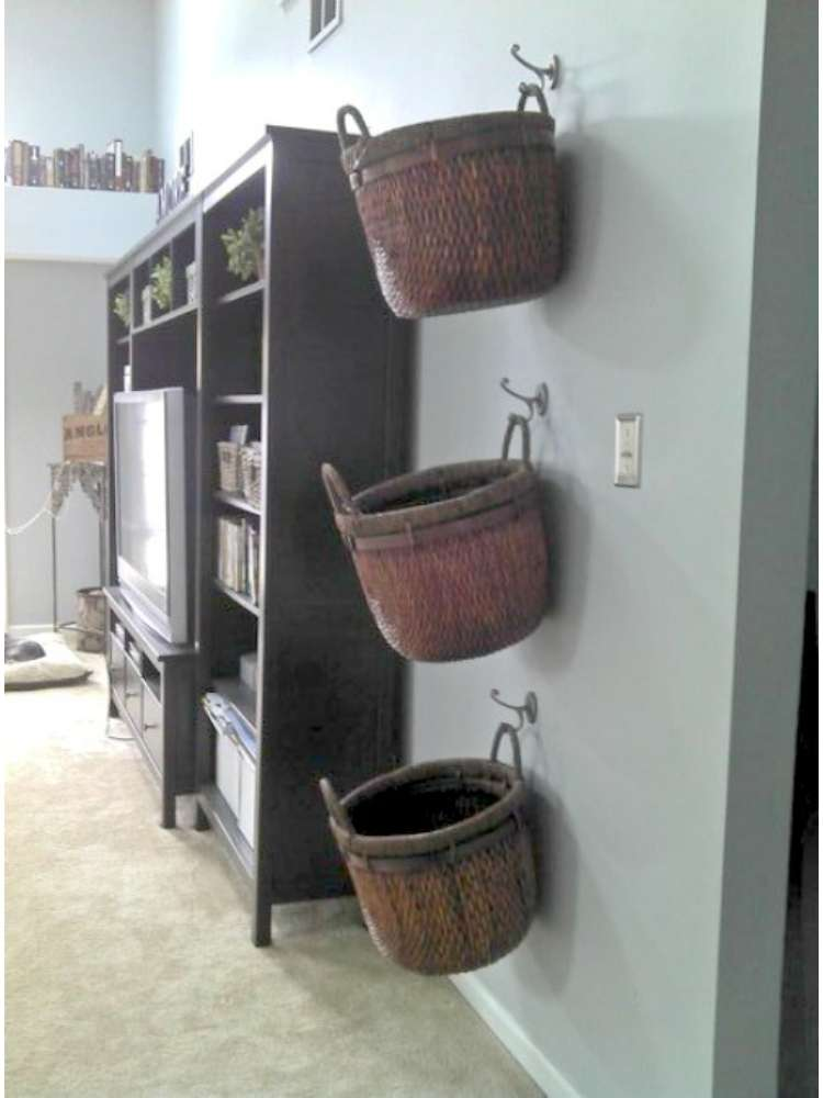 OneCrazyHouse kid friendly living room ideas Baskets hanging on the wall used as storage