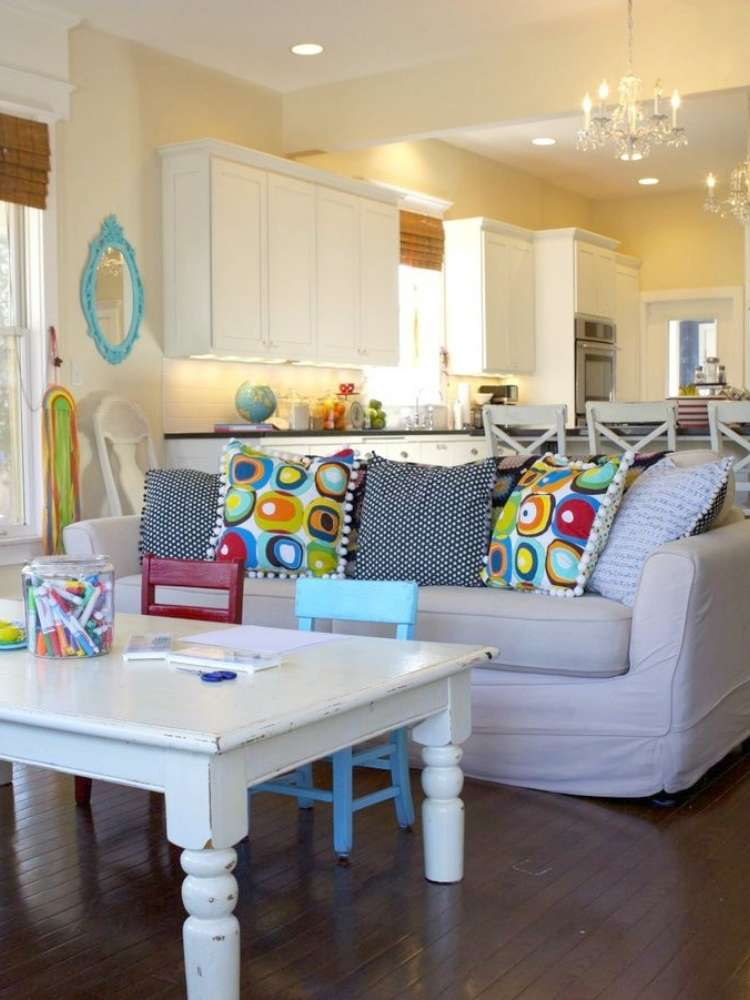 OneCrazyHouse kid friendly living room ideas living room with coffee table in front of the couch with 2 small chairs tucked in under table