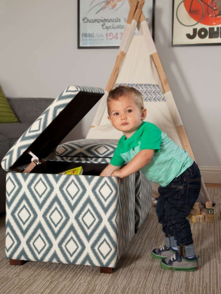 OneCrazyHouse kid friendly living room ideas child in front of mini teepee in living room reaching into a storage cube ottoman