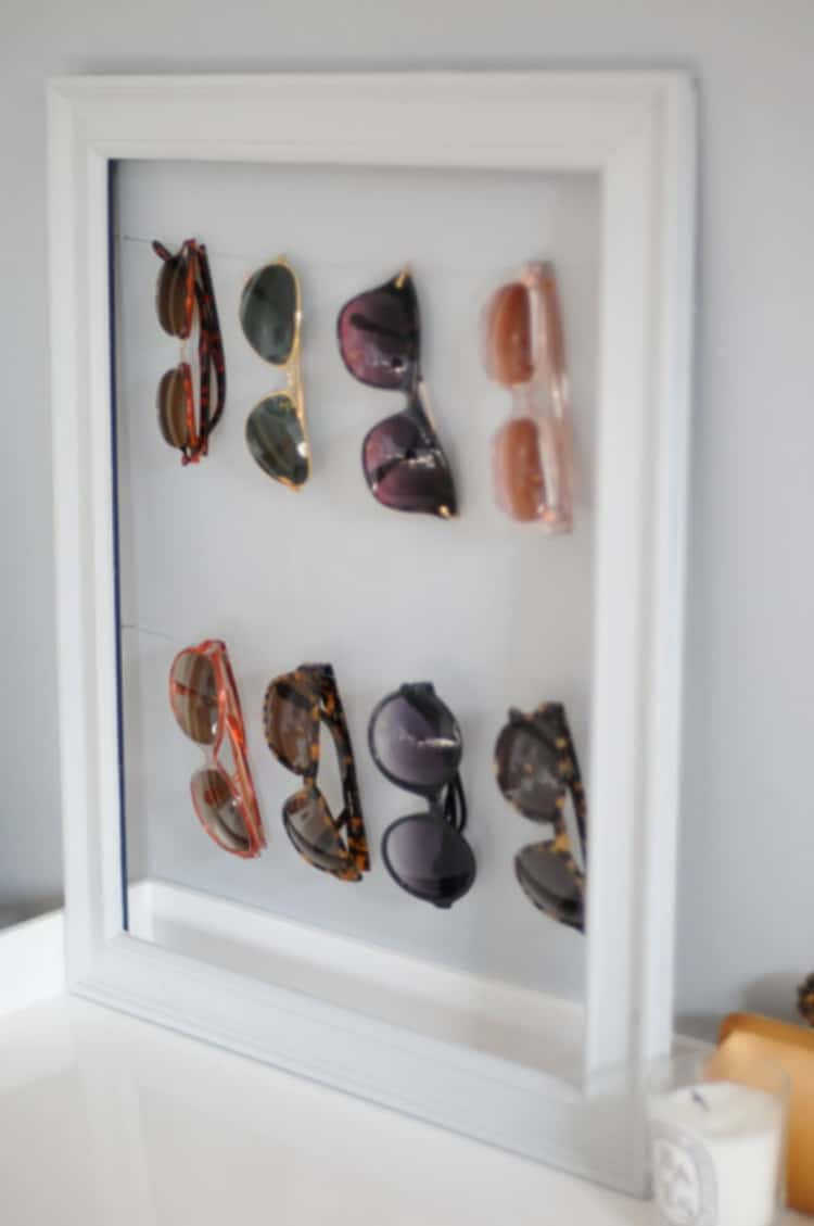 Sunglasses hanged on a picture frame