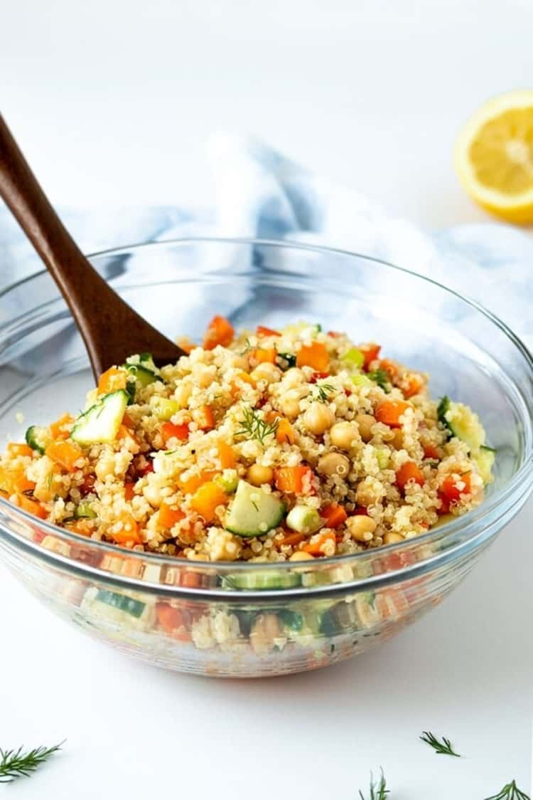 bowl of plant-based meal - quinoa chickpea salad filled with fresh, crisp vegetables, drizzled with a fantastic lemon dill dressing