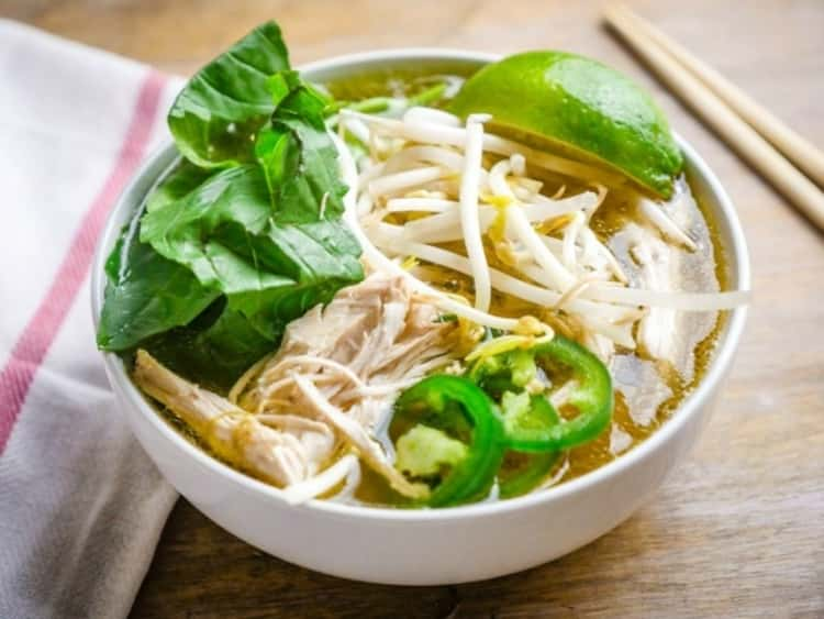 bowl of chicken faux pho soup with mung beans, a lime wedge and sliced jalapenos, Instant Pot Chicken Recipe