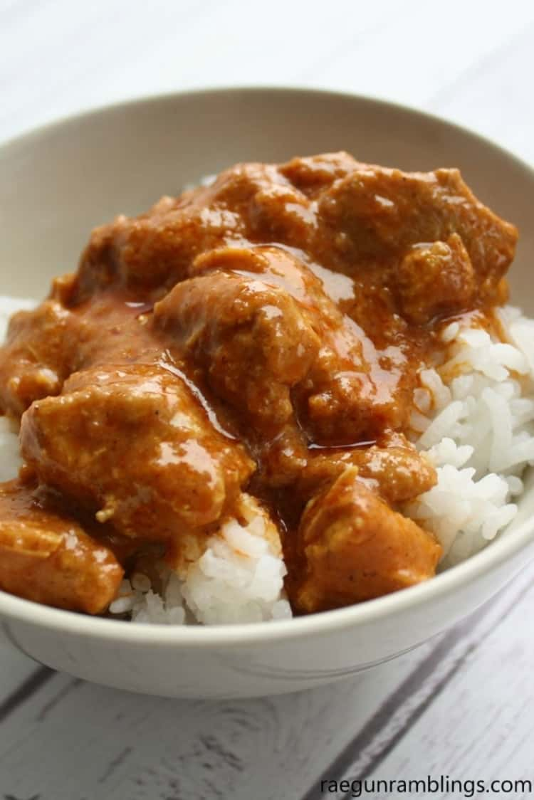 Indian Butter Pressure Cooker Chicken over sticky rice in a bowl , Instant Pot Chicken Recipe