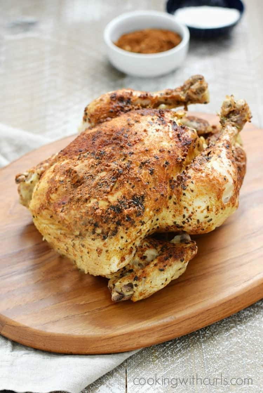 Instant Pot faux rotisserie chicken on a wooden platter