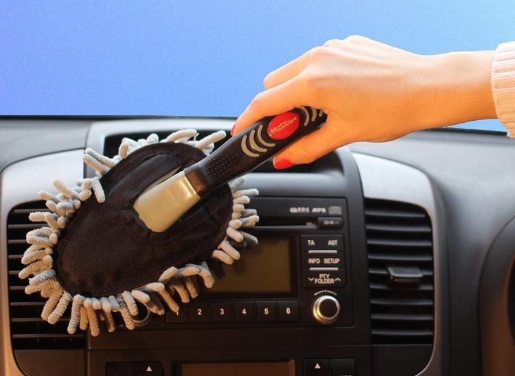 brush dusting car dashboard