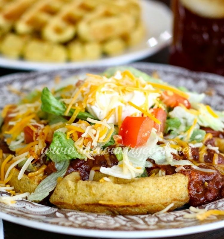 cornbread waffle with chili and all the fixins' on top