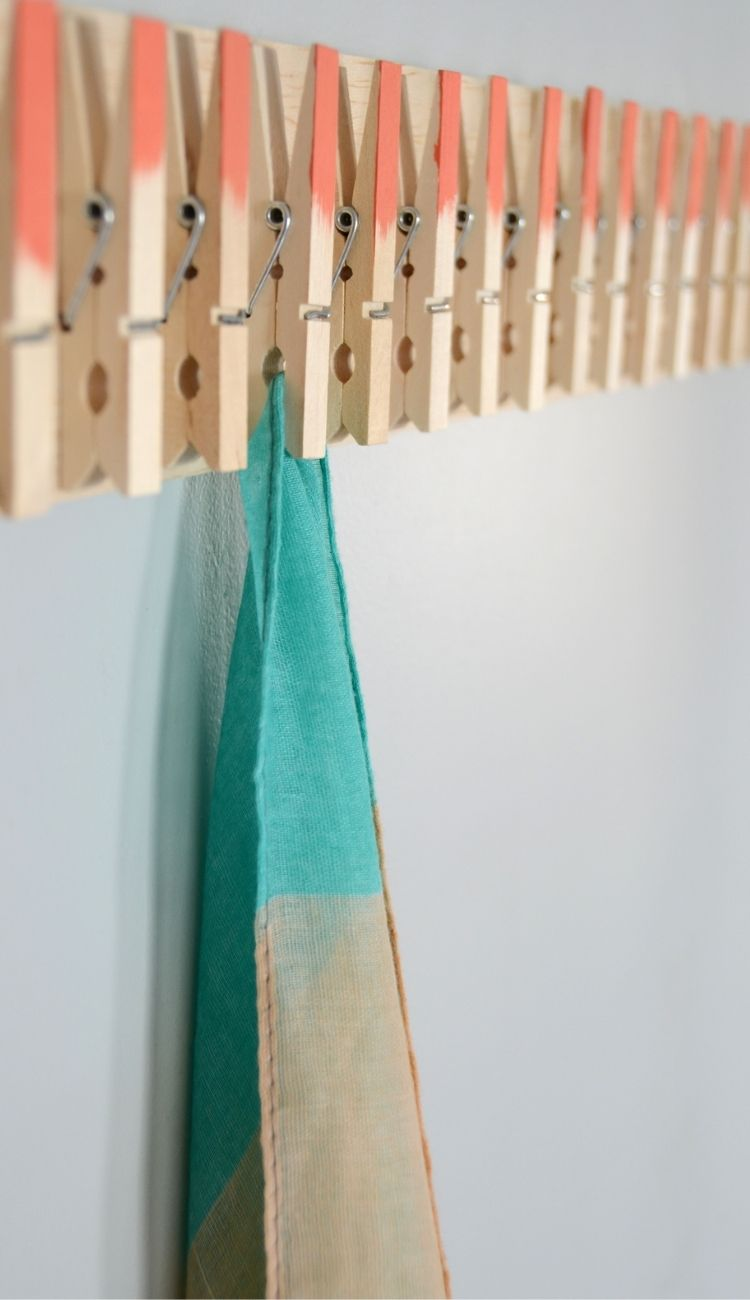 one scarf hanging from a DIY clothespin rack