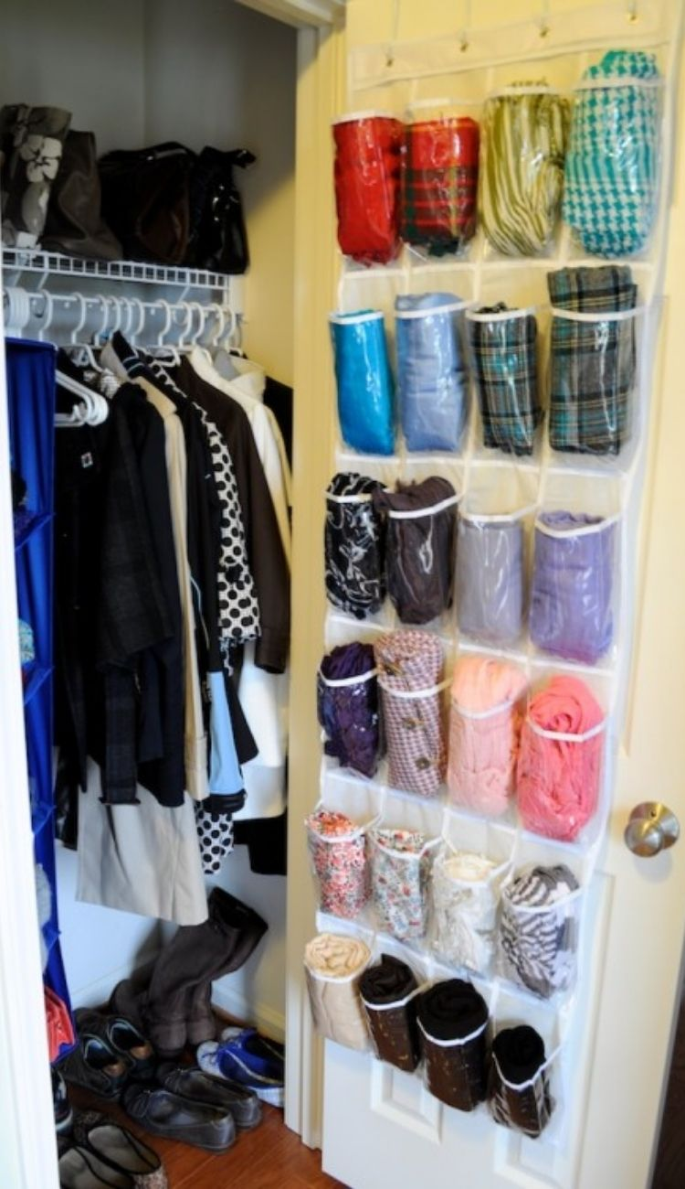 scarves rolled up in over the door shoe organizer