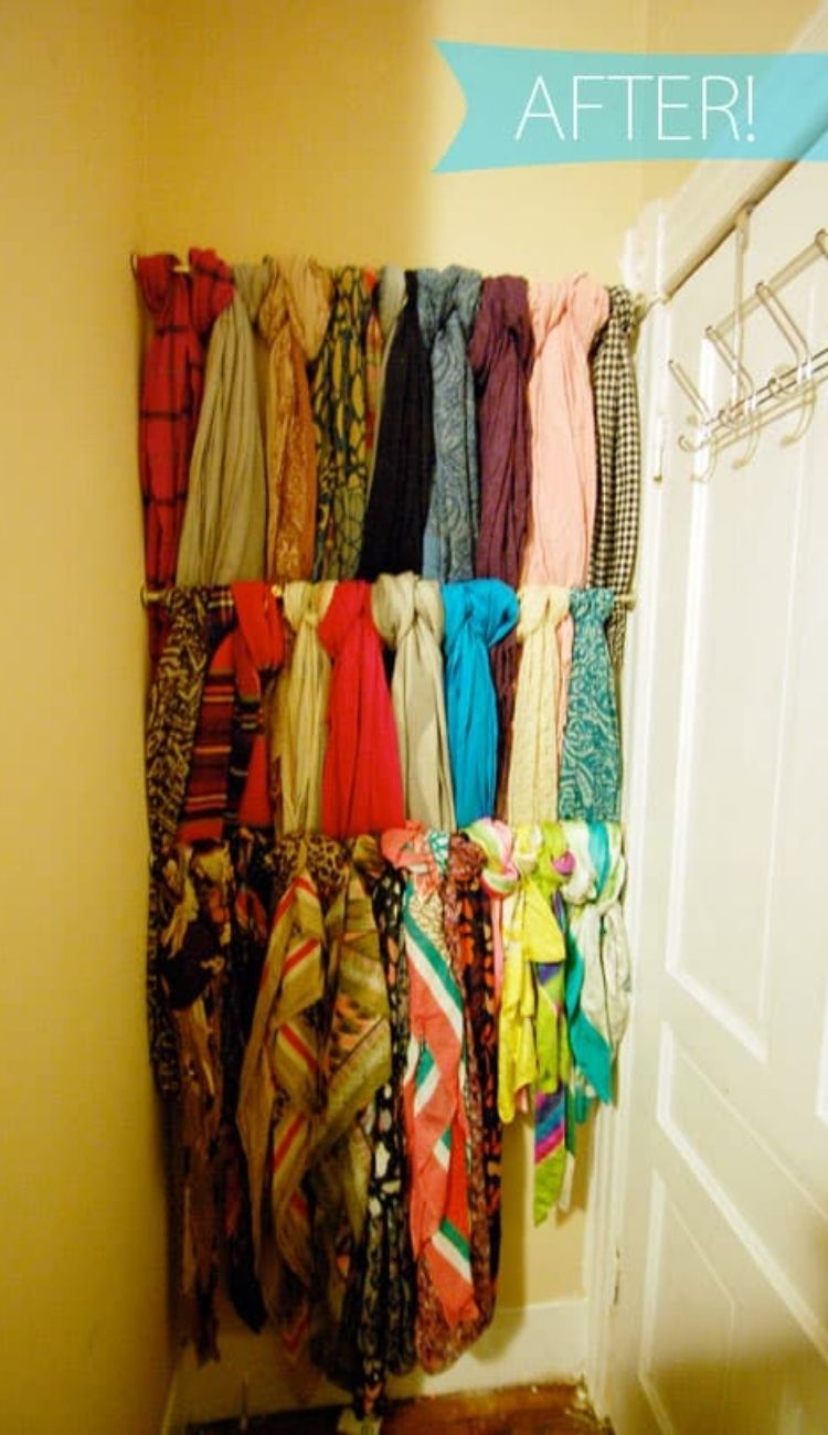 several scarves looped around a tension rod