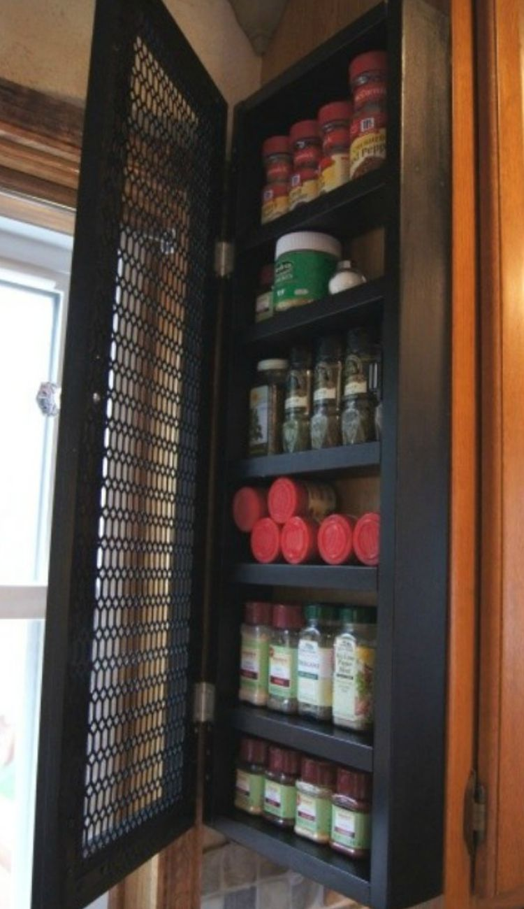 spices in an individual cabinet attached to the end of a pantry cabinet