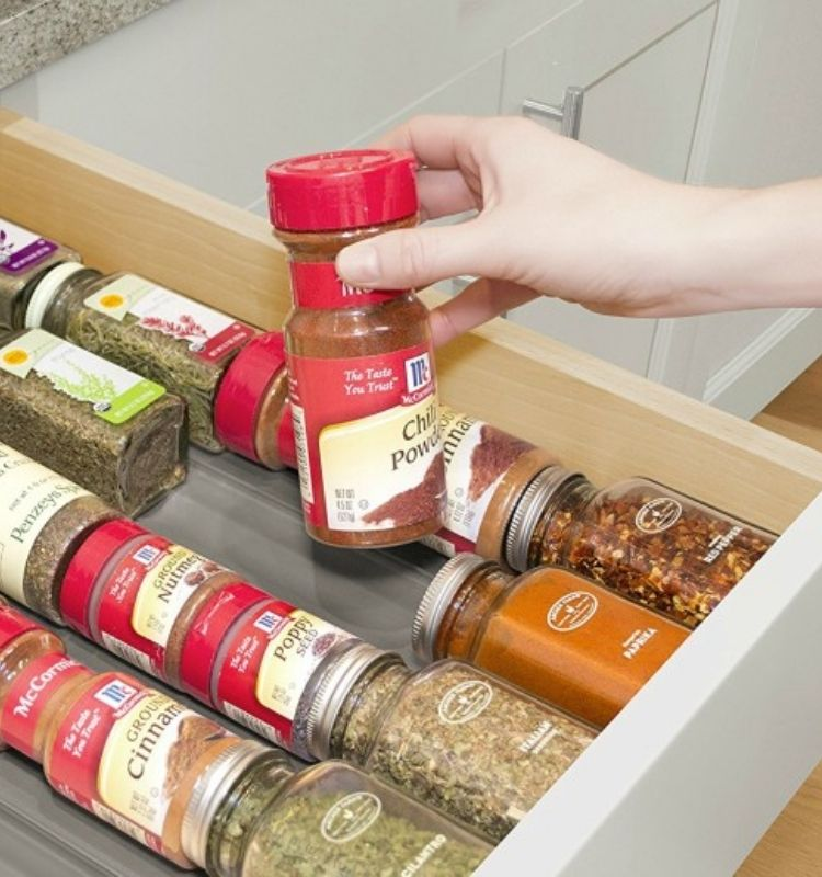 spices in their original jars lined in spiceliners in a drawer